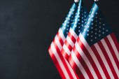 selective focus of usa national country flags isolated on black, memorial day concept