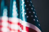 selective focus of united states national country flag isolated on black, memorial day concept