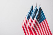 united states of america national flags on flagpoles isolated on grey, memorial day concept