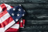 Fotografie folded flag of united states of america on grey wooden surface, memorial day concept