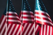 national flags of united states of america isolated on black, memorial day concept