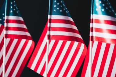 united states of america national flags on flagpoles isolated on black, memorial day concept