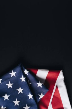 Folded american national flag isolated on black, memorial day concept stock vector