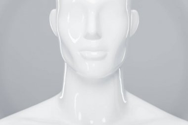 white plastic mannequin figure isolated on grey