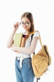 smiling schoolgirl with backpack holding books and glasses isolated on white