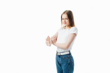 confused teenage girl showing stop gesture isolated on white
