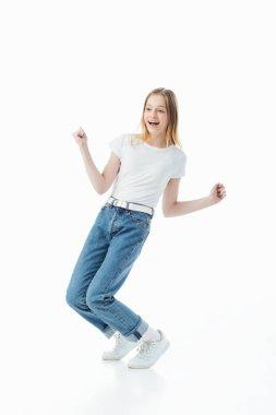 happy teenage girl dancing isolated on white