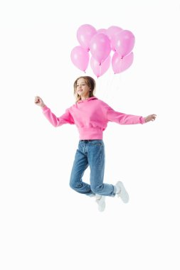 Happy teenage girl with pink balloons jumping isolated on white stock vector