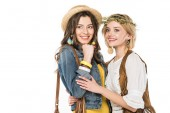 two bisexual hippie girls embracing isolated on white