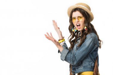 irritated boho girl in boater and denim jacket gesturing isolated on white