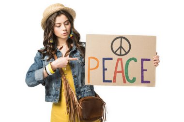 Hippie girl in straw hat pointing with finger at placard with inscription isolated on white stock vector