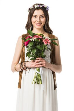front view of pregnant hippie woman in wreath holding flowers isolated on white
