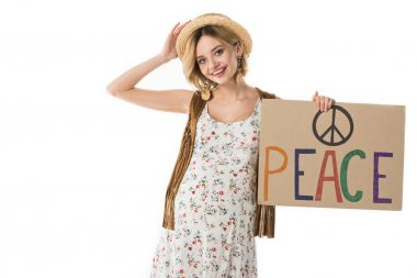 pregnant hippie woman holding placard with inscription isolated on white