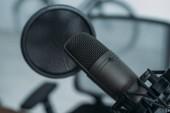 Photo selective focus of microphone with membrane in radio studio