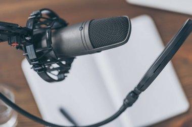 Selective focus of professional microphone in broadcasting studio stock vector