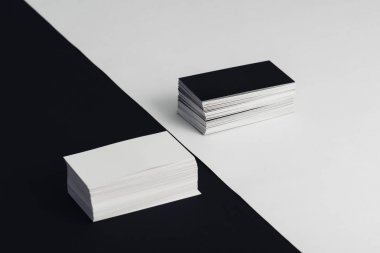 stacks of white and black empty business cards on black and white background