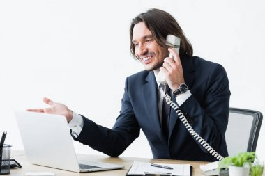 Happy businessman talking on phone and looking at laptop stock vector