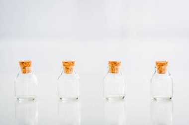 Empty corked glass jars on white background with copy space stock vector