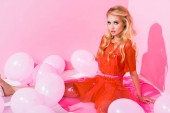 beautiful girl posing near balloons on pink, doll concept