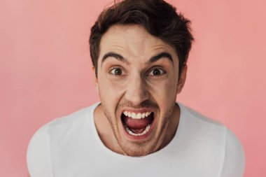 Front view of angry man screaming and looking at camera isolated on pink stock vector