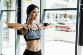 happy young athletic woman working out in sports center