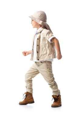 Side view of explorer child in hat standing on white stock vector