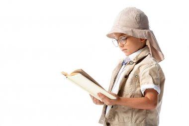 Focused explorer child in glasses reading book isolated on white stock vector