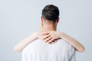 back view of girl embracing man isolated on grey