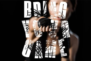 selective focus of woman boxing in glove near bring the game lettering isolated on black