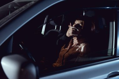 thief attacking beautiful frightened woman in automobile at night