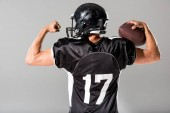 back view of American Football player with ball Isolated On grey