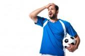 zklamaný fotbalista s koulí a rukou na hlavě izolovaný on White