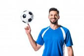 mosolygó csinos futballista spinning a finger labda izolált fehér