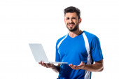 confused soccer player using laptop Isolated On White