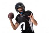 Fényképek Amerikai futball játékos labdát mutatott ujjal izolált fehér