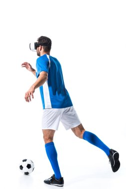 Back view of soccer player in virtual reality headset training with ball Isolated On White stock vector