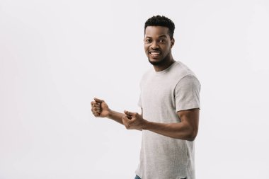 excited african american man gesturing while celebrating isolated on white