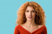 Photo portrait of attractive redhead girl isolated on blue