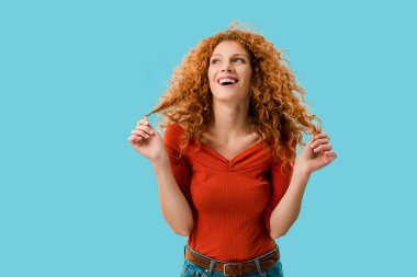 Portrait of laughing redhead girl isolated on blue stock vector