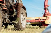 selective focus of modern tractor on wheat field in farm