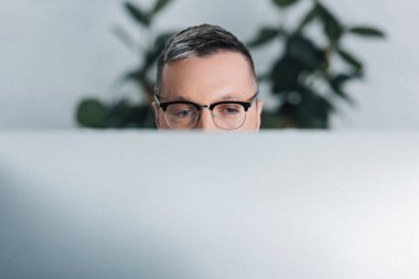 Cropped view of man in glasses looking away in office stock vector