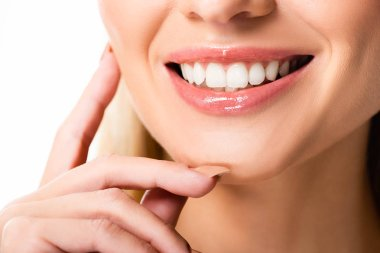 cropped view of smiling woman with white teeth isolated on white
