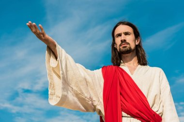Low angle view of jesus with outstretched hand stock vector
