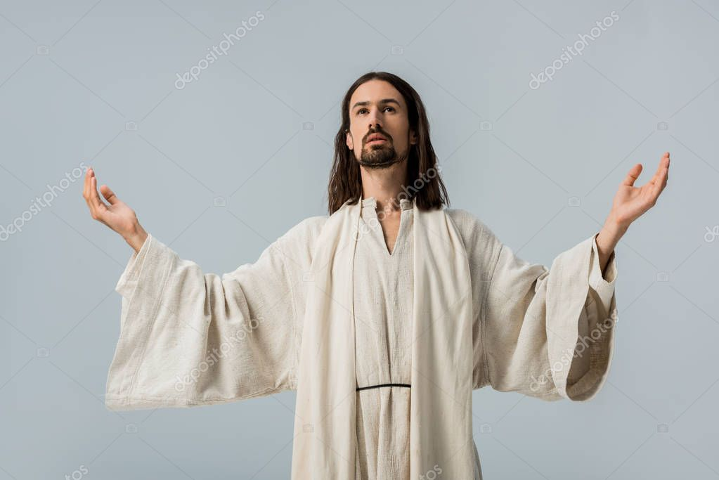 Handsome man in jesus robe with outstretched hands isolated on grey stock vector