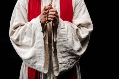 cropped view of religious man holding rosary beads isolated on black