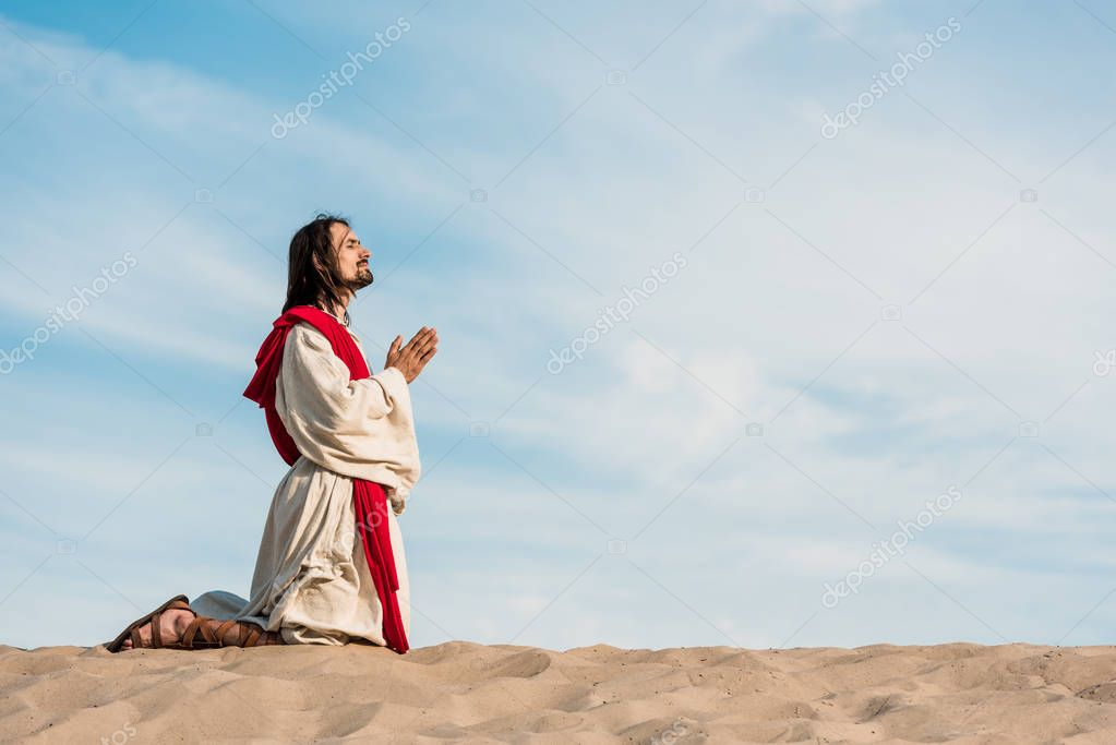 Man praying on knees in desert on golden sand stock vector