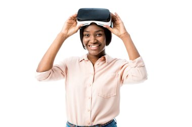 African american woman in shirt with virtual reality headset smiling isolated on white stock vector