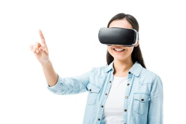 Smiling woman in denim shirt with virtual reality headset pointing with finger isolated on white stock vector