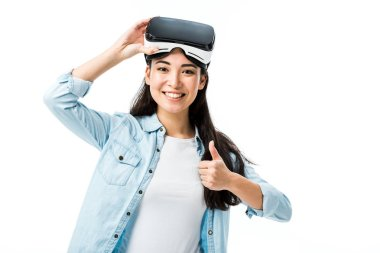 Asian woman in denim shirt with virtual reality headset showing thumb up isolated on white stock vector