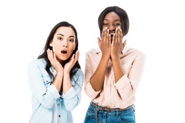 Shocked asian and african american friends looking at camera isolated on white stock vector